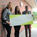 Bianca Valle (C) holds the $10,000 Nordstrom Ten4U Scholarship check she won. She is 1 of 80 national winners, and was surprised during class at her high school. Anita Crandall(R), Diversity Affairs Director for Nordstrom and her counselor made the presenation.