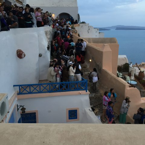 People waiting for the sunset in Oia Santorini