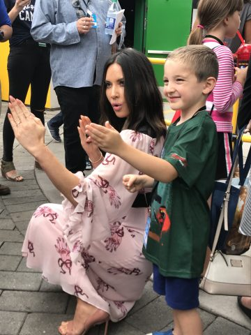 Olivia Munn provides the voice of Koko. Seen here teaching her balck belt moves to a fan.