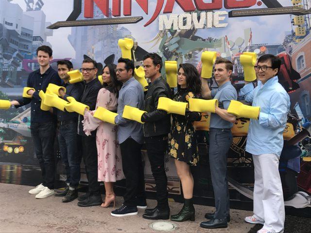 The Lego Ninjago Movie cast shows off their Lego arms.