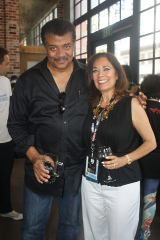 Neil deGrasse Tyson with Suzette Valle at Comic-Con 2016