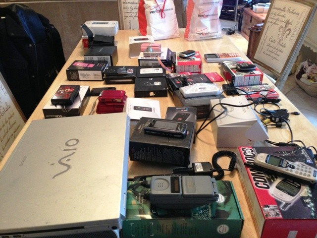 Can you relate to this mess? Recycle old cell phones!