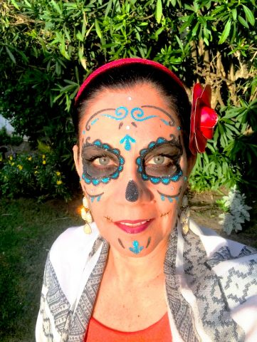 I used stick-on Catrina make-up for a Dia de los Muertos look.